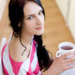 Caucasian young woman with cup of tea — Stock Photo