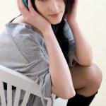 Caucasian dark haired woman with earphones — Stock Photo