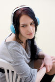 Caucasian dark haired woman with earphones — Stock Photo