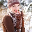 Winter girl basking outdoors — Stock Photo