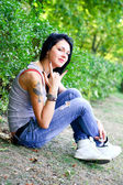Grunge girl in the summer day in park outside — Stock Photo