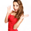 Girl in a red dress showing surprised isolated on white backgrou — Stock Photo #19214315