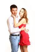 在爱中年轻夫妇抱着被隔绝在白色背景上 — 图库照片
