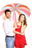 Romantic young couple with umbrella isolated on white background — Stock Photo