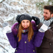 Happy young couple in winter park outdoors — Stock Photo