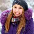 Smiling girl in a winter park outdoors - Stock Photo