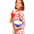 Pretty smiling girl with popcorn and a cup isolated on white bac — Stock Photo #19657201