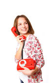 Happy girl with a red old antique telephone isolated on white ba — Stock Photo