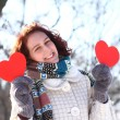 Romantic winter girl with two red hearts outdoors — Stock Photo