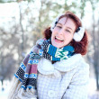 Laughing winter girl holding a snow in hands outdoors — Stock Photo #19713383