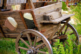 Wooden cart on grass outdoors — Stock Photo