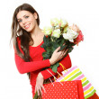 Lovely girl with shopping bags and roses on a white background — Stock Photo