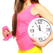 Stock Photo: Athletic young womwith clock and dumbbells