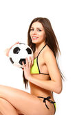 Attractive young woman with a soccer ball on a white background — Stock Photo