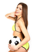 Happy girl posing with a soccer ball on a white background — Stock Photo