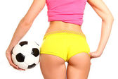 Athletic woman posing with a soccer ball on a white background, — Stock Photo