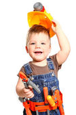 Happy little boy in an orange helmet and tools on a white backgr — Stock Photo