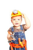 Boy in the orange helmet with tools on a white background — Stock Photo