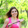 Girl posing with skipping rope on background of trees — Foto Stock #24858059