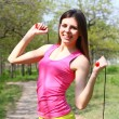 Foto Stock: Girl posing with skipping rope on summer day
