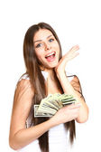 Happy young woman holding dollars on a white background — Stock Photo