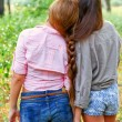 Two girlfriends with pigtail outdoors — Stock Photo #30540089