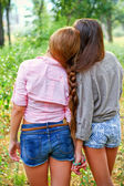 Two girlfriends with a pigtail outdoors — Stock Photo