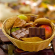 Apples, oatmeal cookies, chocolate in the basket in the autumn p — Stock Photo