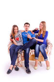 Young people sitting on a sofa and drinking Coca Cola — ストック写真