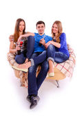 Friends sitting on a sofa and drinking Coca Cola — Stockfoto