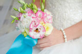 Bride holding wedding bouquet close up — Stock Photo