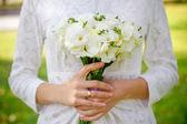 Bride holding wedding bouquet close up — Stock Photo