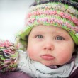 Happy baby on the winter background — Stock Photo