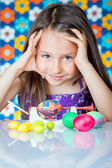 Cute little girl painting Easter eggs — Stock Photo