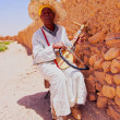 Stock Photo: Mplaying traditional moroccinstrument.