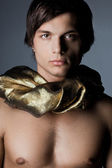 Young man in golden scarf — Stock Photo