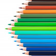 Many colored pencils in row over white background — Stock Photo #16822383