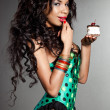Elegant mulatto girl with cake - Stock Photo