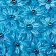 Stock Photo: Beautiful texture with fabric flowers