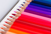 Many colored pencils in a row — Stock Photo