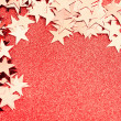 Festive stars on red background — Foto Stock