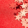 Festive stars on red background - Stock Photo