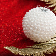 Stock Photo: Branch of Christmas tree with festive ball