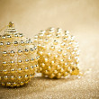 Christmas balls on sparkles background — Stock Photo
