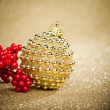 Christmas ball with european holly - Stock Photo