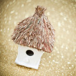 House with a thatched roof on a festive background - Foto Stock