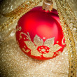 Christmas ball with golden ribbon - Foto Stock