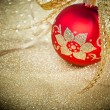 Christmas ball with golden ribbon - Stok fotoğraf