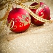 Christmas balls with golden ribbon — Stock Photo #16968195
