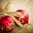 Christmas balls with golden ribbon - Stockfoto